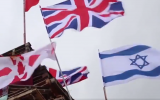 British and Israeli flags on a bonfire that was later set ablaze on August 15, 2018 in Derry, Northern Ireland. (Screenshot: Twitter)