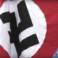 Illustrative: A Nazi flag flown in the United States. (Screenshot: YouTube)