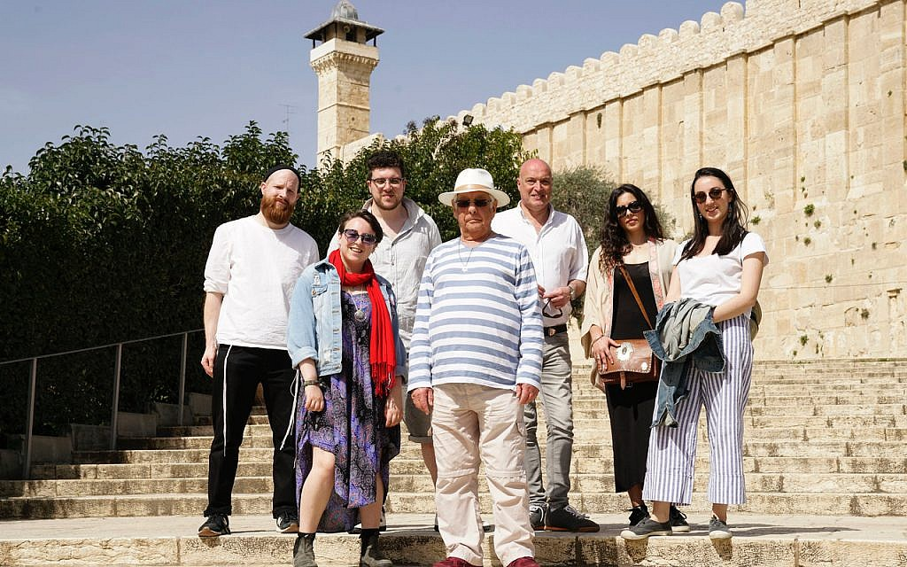 From the BBC TV program 'We Are British Jews,' left to right: Joseph, Emma, Simon, Alan, Damon, Ella and Lilly standing on the steps at the Tomb of the Patriarchs. (Lion TV/ Strahila Royachka)