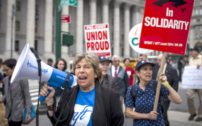 Weingarten, with megaphone, marches in a New York City rally, June 27, 2018. (Courtesy Professional Staff Congress/via JTA)