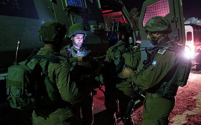 Israeli soldiers conduct a raid in the southern West Bank on August 14, 2018. (Israel Defense Forces)