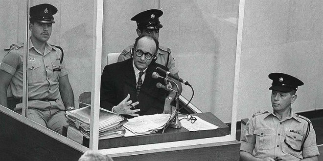 Image result for A photo taken during the trial of Adolf Eichmann.