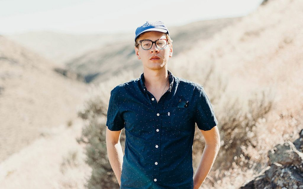 Ben Fisher's album 'Does the Land Remember Me?' explores the history of Israel from Israeli and Palestinian viewpoints. (Kendall Rock/via JTA)