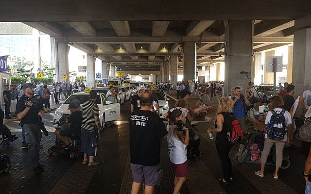 Disabled rights activists block traffic at entrance to Ben Gurion Airport, August 7, 2018. (Twitter screenshot/Kan)