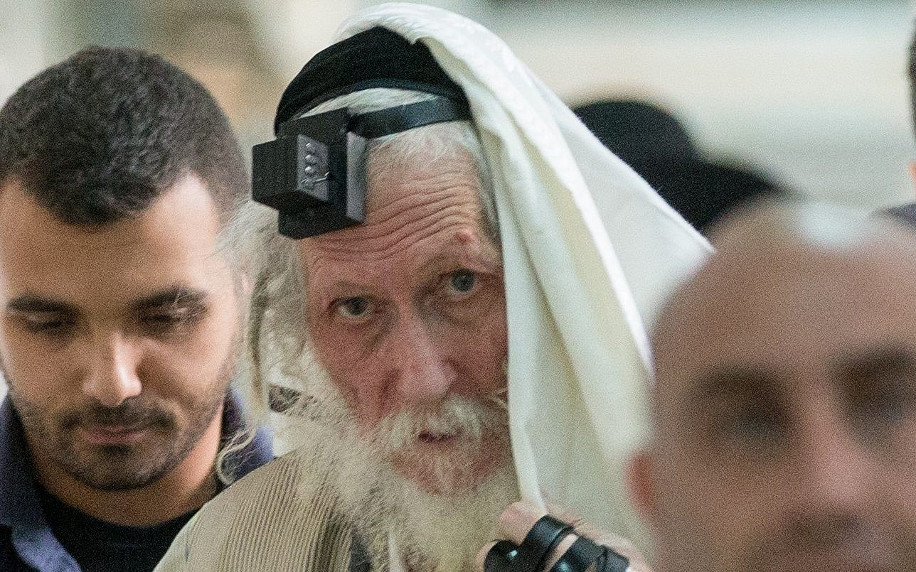The ex-aides of a messianic, sex-convict rabbi fight from within to