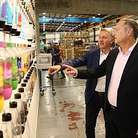 SodaStream CEO Daniel Birnbaum (r) and PepsiCo's CEO Ramon Laguarta at the SodaStream factory in Israel's Negev Desert next to the city of Rahat on August 20, 2018. (Eliran Avital)