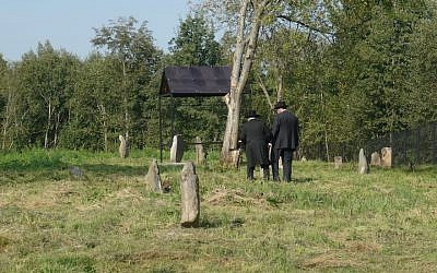 Visitors explore one of the Jewish cemeteries in Lyubavichi, August 26, 2018. (Cnaan Liphshiz)
