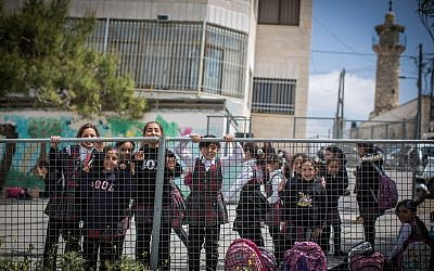 Illustrative image of Palestinian schoolgirls in their small playground in the East Jerusalem neighborhood of Shuafat, on March 30, 2016. (Hadas Parush/Flash90)