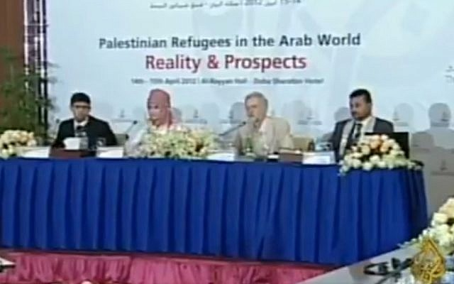 UK Labour party leader Jeremy Corbyn (second right) attends a 2012 conference in Doha along with several Palestinian terrorists convicted of murdering Israelis. (Screen capture: Twitter)