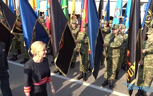 Croatian President Kolinda Grabar-Kitarovic reviews the troops at a ceremony marking the country's 1995 victory over Serbia. (Screen capture: YouTube)