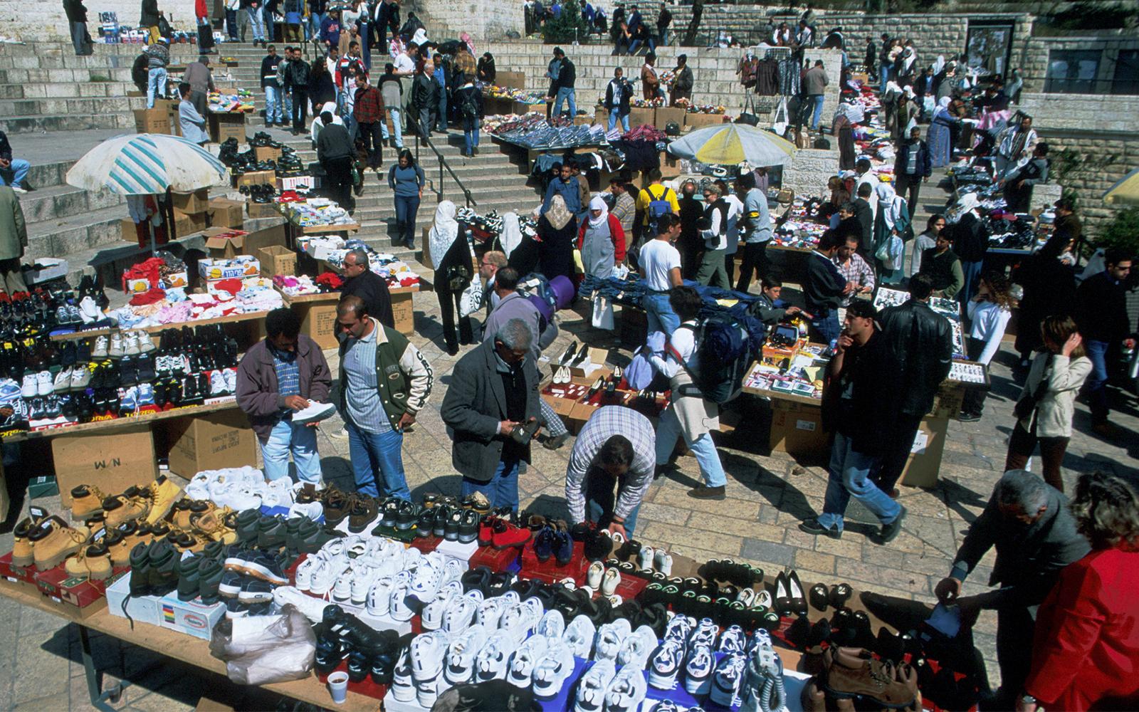 Residents hawk their wares outside Damascus Gate. (Shmuel Bar-Am)