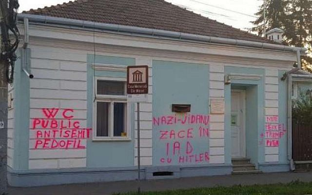 Elie Wiesel's childhood home in Sighet, Romania was vandalized with anti-Semitic graffiti on August 3, 2018. (Screenshot via Realitatea.net)