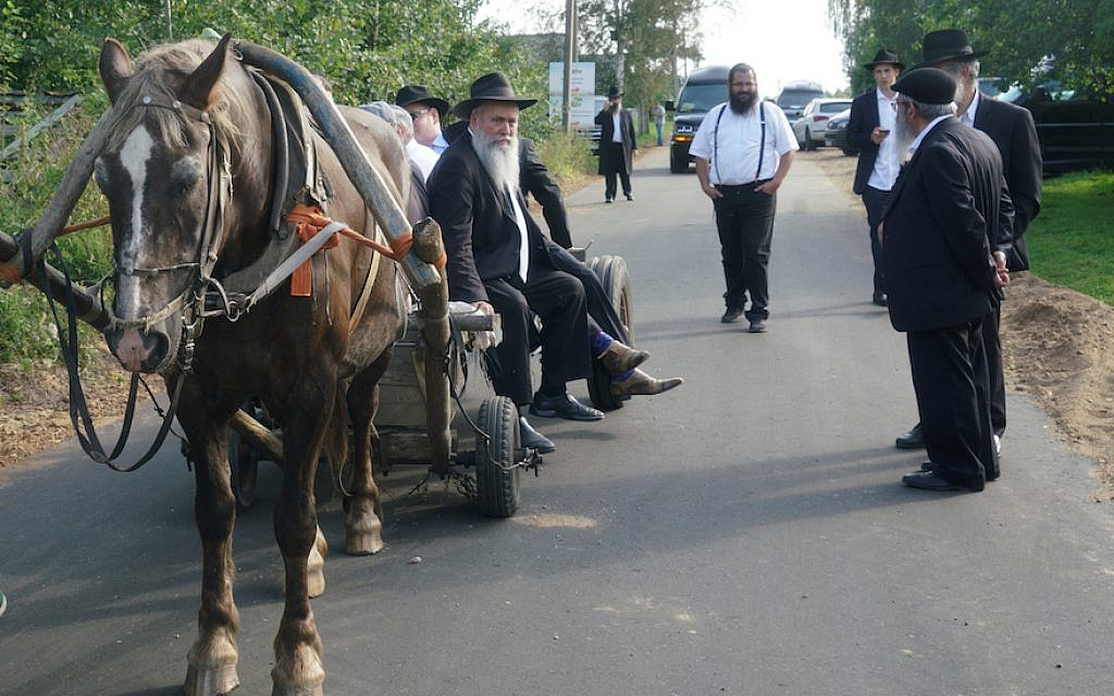 Rabbi Jehoshua Raskin shares a ride with other visitors to Lyubavichi, Russia, August 26, 2018. (Cnaan Liphshiz)