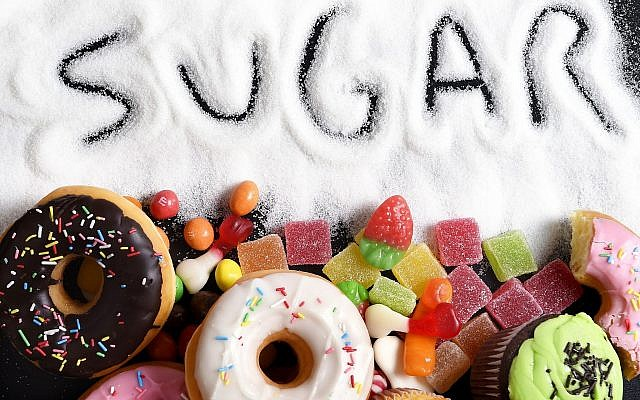 Illustrative image of sweet cakes, donuts and candy with sugar. (iStock by Getty Images, OcusFocus)