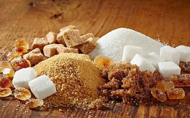 Various types of sugar on a wooden table. (iStock by Getty Images, MagoneJ)