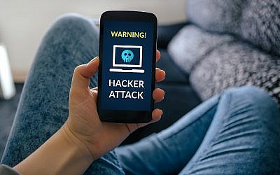 Illustrative: A smart phone with a warning of a hacking attack. (iStock from Getty Images/ CarmenMurillo)