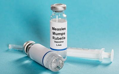 Measles Mumps Rubella Vaccine Vials With Syringe. (iStock by Getty Images/ AndreyPopov)