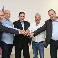 Left to right: Ofer Bloch, the CEO of Israel Electric Corp., Ami Erel, the chairman of Cellcom; Yiftach Ron-Tal, chairman of Israel Electric; Nir Sztern, CEO of Cellcom and Doron Cohen, the CEO of IBC; Aug.8, 2018  (Yossi Weiss, Israel Electric Corp)