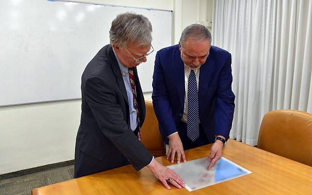 Defense Minister Avigdor Liberman (R) meets with US National Security Adviser John Bolton in Jerusalem on August 20, 2018. (Ariel Hermoni/Defense Ministry)
