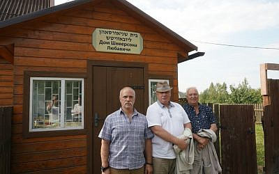 District Mayor Yuri Ivashkin, center, and his employees stand outside a Jewish cemetery in Lyubavichi, August 26, 2018. (Cnaan Liphshiz)