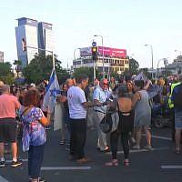 Dozens of activists close Tel Aviv's Azrieli Junction for an hour on August 28, 2018. (Screen capture: Ynet news)