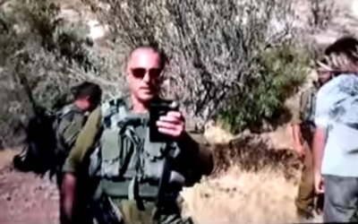 St. Sgt. Alon Segev, 40, an IDF reservist, was filmed on August 11, 2018 by a member of the Ta'ayush Jewish-Arab rights group in the Hebron Hills area striking the activist. (YouTube screen capture)
