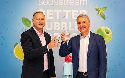 Newly elected CEO of PepsiCo, Ramon Laguarta (right), and SodaStream's Daniel Birnbaum at the signing of the acquisition deal, August 20, 2018, at SodaStream's offices in Israel (Lens Productions)