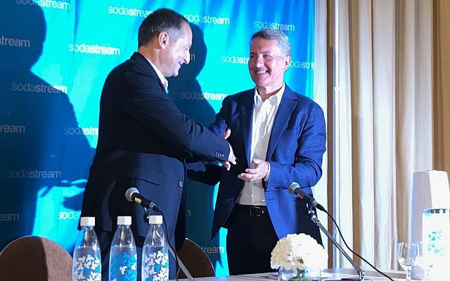 SodaStream's Daniel Birnbaum, left, and PepsiCo's newly appointed CEO Ramon Laguarta at a press conference in Tel Aviv (Shoshanna Solomon/Times of Israel)