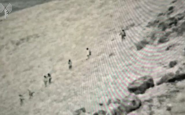 Surveillance footage released by the IDF that it says shows a group of armed jihadist fighters in southern Syria approaching the Israeli border on August 2, 2018. (courtesy: IDF)