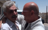 Ephraim Talabi, right, and Mohammed Amin a-Sati meeting for the first time 36 years after the First Lebanon War, at a-Sati's home in Zarqa, Jordan, July 2018. (Hadashot screen capture)