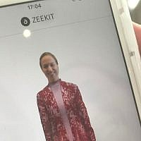 "Close up of Yael Vizel ""wearing"" an article of clothing from the Decoding Israeli Dress exhibition, on the Zeekit app; July 31, 2018 (Ariella Gentin)"