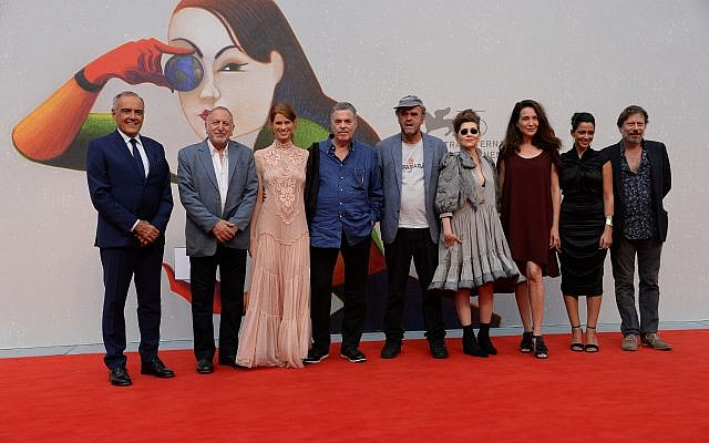 Some of the actors from Amos Gitai's newest film, 'A Tramway in Jerusalem,' including Yuval Sherf (third from left) and Yael Abecassis (third from right) in Venice on September 3, 2018 (Courtesy Awakening)
