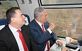 Prime Minister Benjamin Netanyanu (r) and Transportation and Information Minister Yisrael Katz ride the inaugural high-speed train from Jerusalem to Ben Gurion airport on September 20, 2018. (Amos Ben-Gershom / GPO)