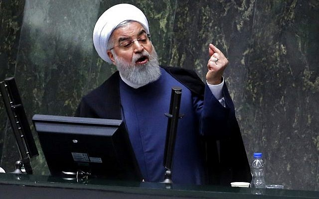 Iran's President Hassan Rouhani speaks at the Iranian Parliament in the capital Tehran on August 28, 2018. (AFP Photo/Atta Kenare)
