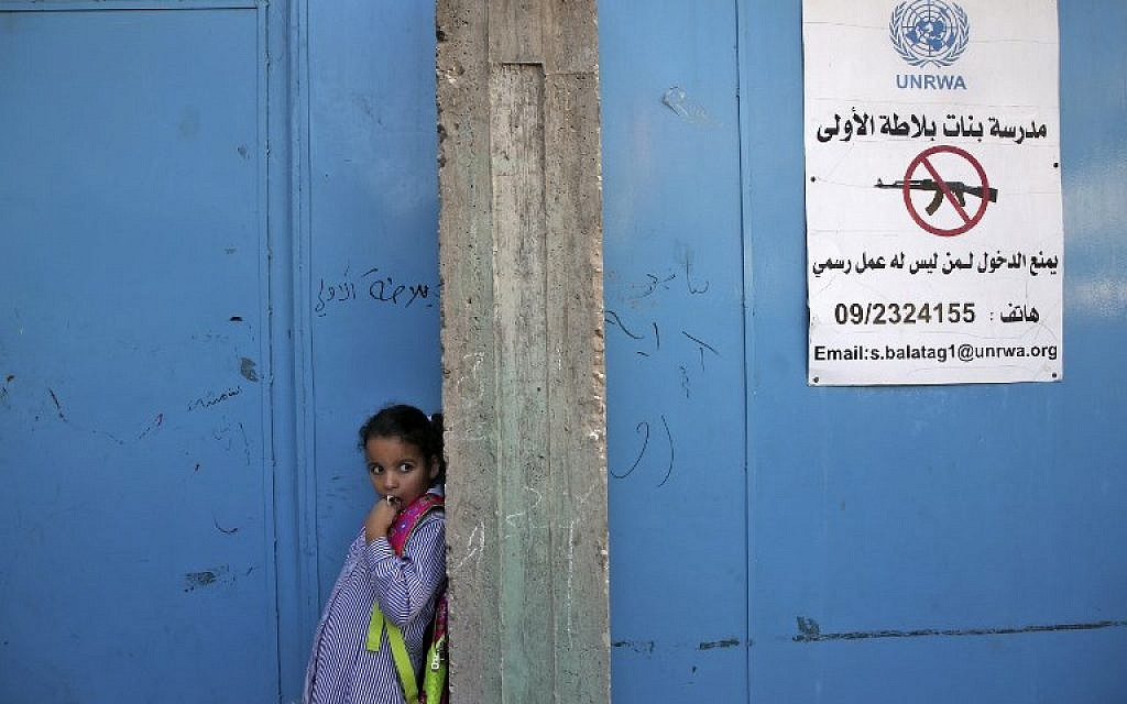 A girl stands at the entrance of a school run by United Nations Agency for Palestinian Refugees (UNRWA) in Balata refugee camp, east of Nablus in the West Bank on August 29, 2018. (AFP PHOTO / Jaafar ASHTIYEH)