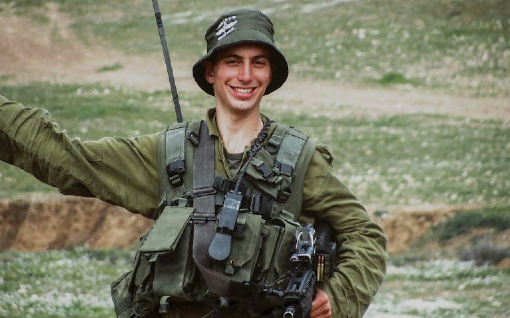 This picture taken on August 29, 2018 shows a reproduction of a photo of Israeli soldier Lieutenant Hadar Goldin taken while on army duty, as shown by his parents at their family home in the city of Kfar Saba. (AFP PHOTO / JACK GUEZ)