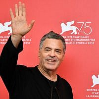 "Israeli director Amos Gitai attends a photocall for the film, ""A Letter to a Friend in Gaza,"" presented out of competition on September 3, 2018, during the 75th Venice Film Festival, at Venice Lido. (AFP PHOTO / Alberto PIZZOLI)"