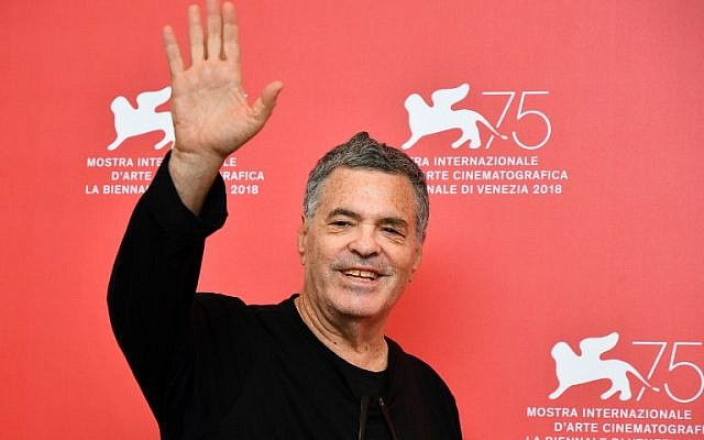 """Israeli director Amos Gitai attends a photocall for the film """"A Letter to a Friend in Gaza,"""" presented out of competition on September 3, 2018, during the 75th Venice Film Festival, at Venice Lido. (AFP Photo/Alberto Pizzoli)"""