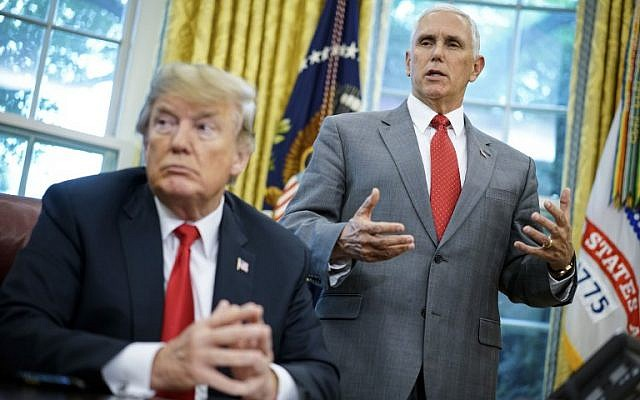 In this file photo taken on June 20, 2018 US Vice President Mike Pence speaks as US President Donald Trump looks on before signing an executive order on immigration in the Oval Office of the White House in Washington, DC. (AFP PHOTO / Mandel Ngan)