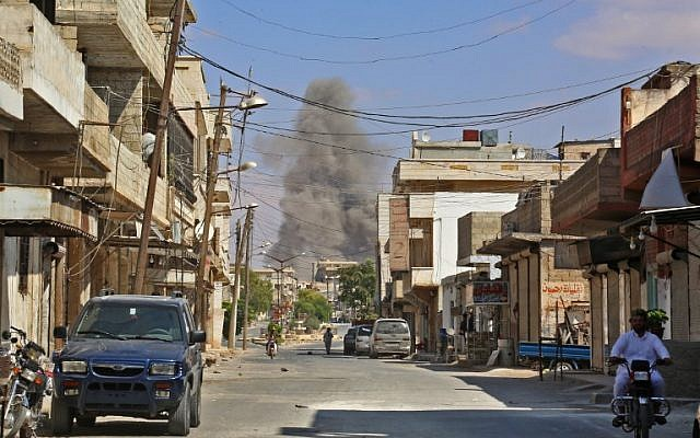 This picture taken in Kafr Ain on September 7, 2018, shows smoke rising as government forces target the city, 4 kilometers east of Khan Shaykhun in the southern countryside of Idlib province. (AFP/ Anas AL-DYAB)