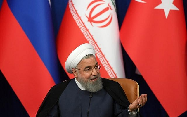 Iranian President Hassan Rouhani speaks during a press conference in Tehran, September 7, 2018. (AFP/Kirill Kudryavtsev/Pool)