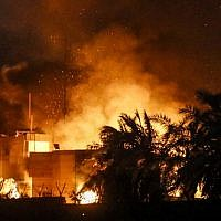 The Iranian consulate in the southern Iraqi city of Basra is seen after it was stormed and set ablaze by protesters during demonstrations over poor public services. (AFP Photo/Haidar Mohammad Ali)