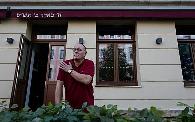 Uwe Dziuballa, owner of the Schalom restaurant in Chemnitz, eastern Germany, describes to a journalist on September 8, 2018, how he was hit in the shoulder with a rock when his Jewish restaurant was attacked by a group of masked men on August 27, 2018. (AFP Photo/John MacDougall)