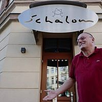 Uwe Dziuballa, owner of the 'Schalom' restaurant in Chemnitz, eastern Germany, describes to a journalist on September 8, 2018, how his restaurant was attacked by a group of masked men on August 27, 2018 in an apparent anti-Semitic attack. (AFP/John MacDougall)