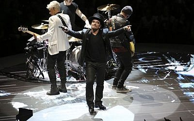 Irish lead singer of rock band U2, Bono, center, performs on stage in Paris on September 8, 2018. (Zakaria ABDELKAFI/AFP)