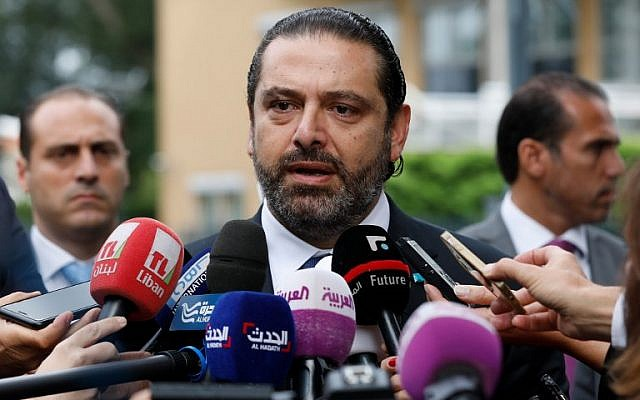 Lebanese premier-designate Saad Hariri speaks to the press in front of the Special Tribunal for Lebanon after the presentation of the closings arguments in the trial of four Hezbollah suspects accused of 2005 assassination of his father the late Lebanese prime minister on September 10, 2018, in The Hague.   (AFP PHOTO / ANP / Bas CZERWINSKI )