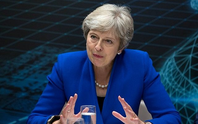 Britain's Prime Minister Theresa May addresses business leaders at the Zero Emission Vehicle Summit in Birmingham, central England on September 11, 2018. (AFP PHOTO / POOL / Aaron Chown)