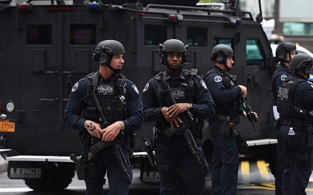 Port Authority Police Department Counter-Terrorism Police patrol during observances on September 11, 2018  held on the 17th anniversary of the September 11, 2001, terror attacks at the annual ceremony at the Ground Zero memorial site in New York. (AFP/TIMOTHY A. CLARY)