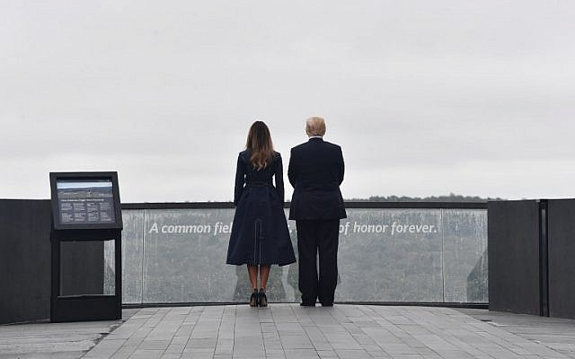 US President Donald Trump and First Lady Melania Trump arrive at the site of a new memorial on September 11, 2018 in Shanksville, Pennsylvania, where Flight 93 crashed during the September 11 attacks, as somber ceremonies take place at Ground Zero in New York and at the Pentagon.( AFP PHOTO / Nicholas Kamm)