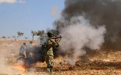 """A Syrian rebel fighter from the recently-formed """"National Liberation Front"""" takes part in combat training at an unknown location in the northern countryside of the Idlib province on September 11, 2018, in anticipation for an upcoming offensive by government forces. (AFP Photo/Aaref Watad)"""